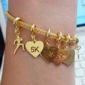 pulseira-feminina-com-pingentes-de-corrida-banhado-em-ouro-18k