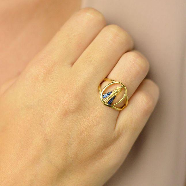 anel-nossa-senhora-aparecida-cravejado-com-zirconias-azuis-banhado-em-ouro-18k